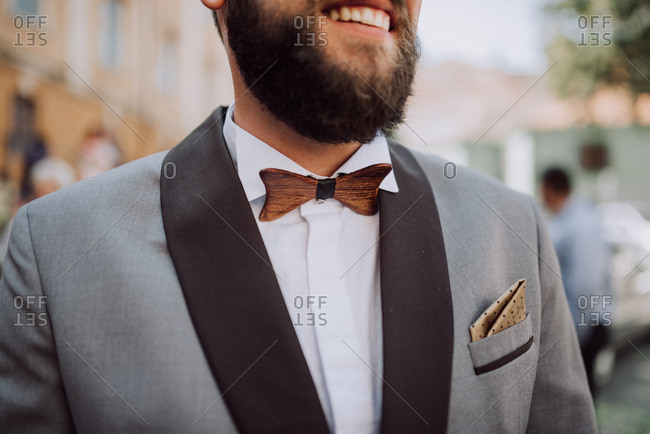 Groom wearing wooden bowtie and suit jacket