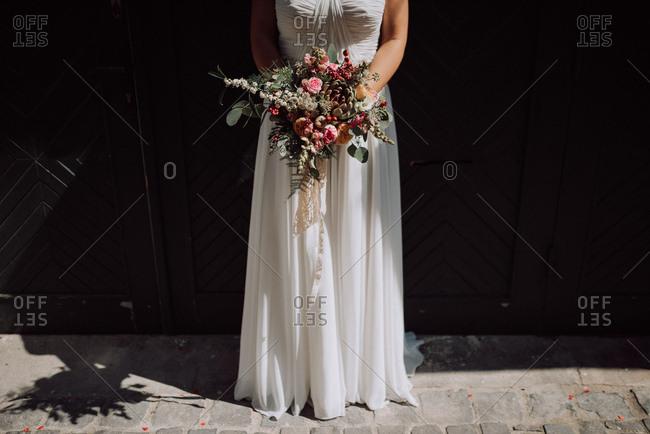 Bride holding beautiful floral bouquet