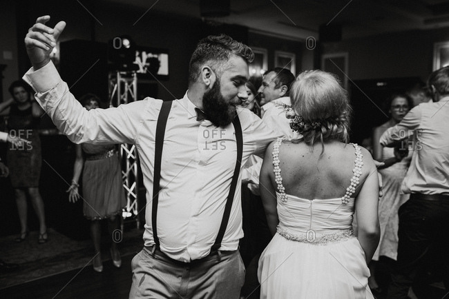 Bride and groom dancing at their wedding reception in black and white