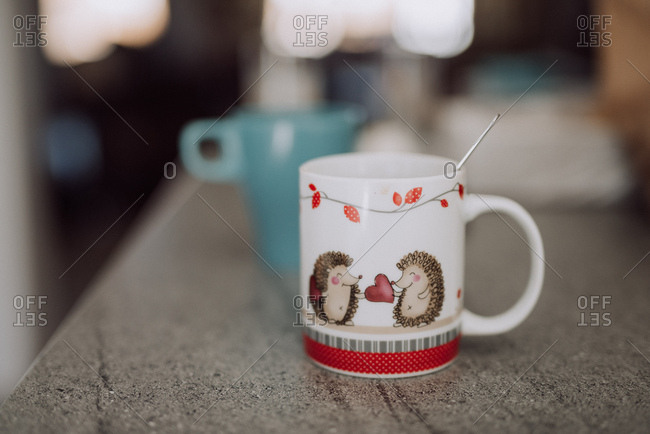 Porcupines and hearts on a coffee mug