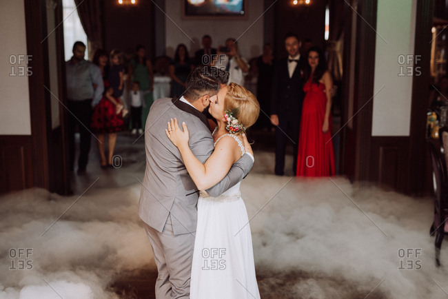 Bride and groom dancing surrounded by smoke