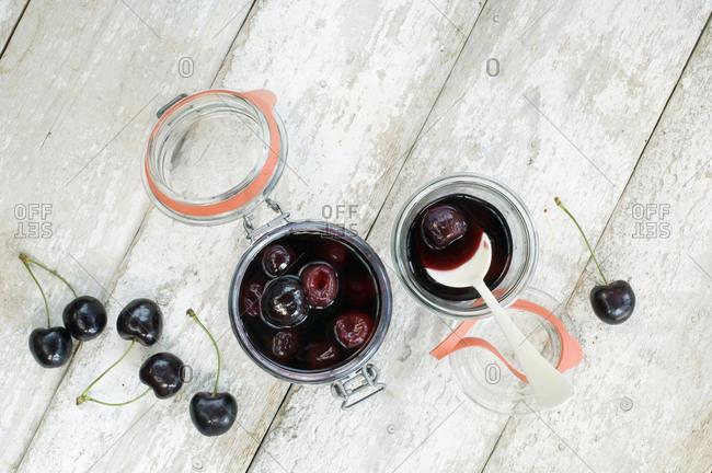 Stewed cherries in jar