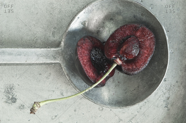 Halved cherry in ladle - Offset