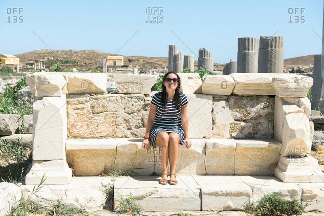 Greece- Mykonos- Delos- tourist visiting archaeological site