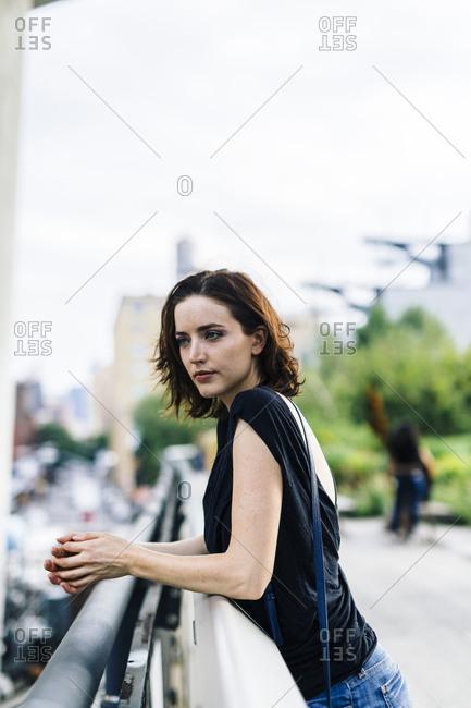 USA- New York City- portrait of  woman on High Line Park in Manhattan
