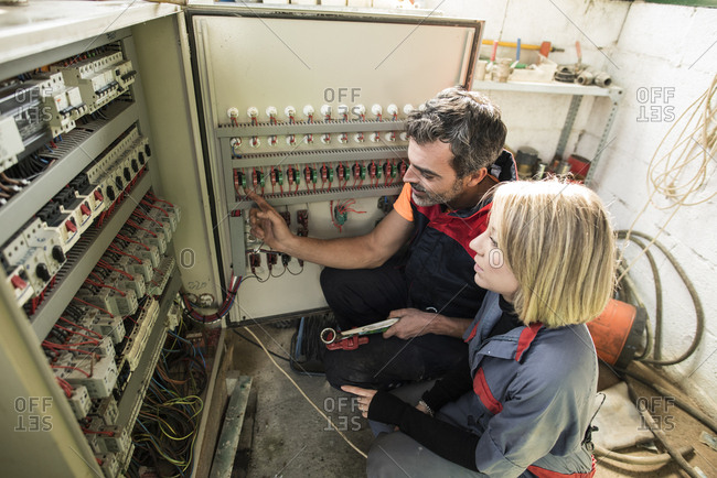 Couple checking fuse box