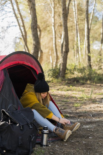 Young woman in tent in the nature