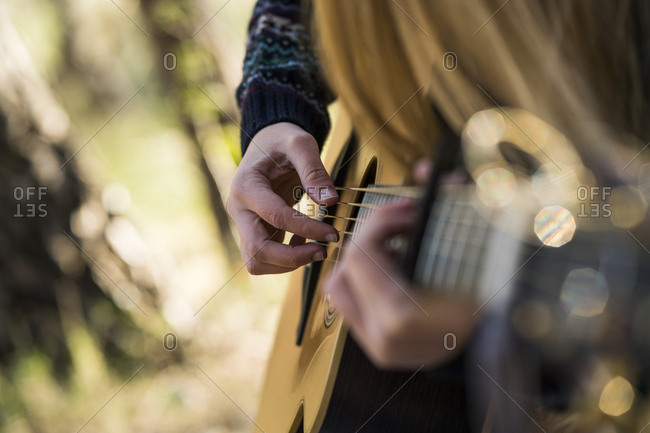 Hands of woman playing guitar