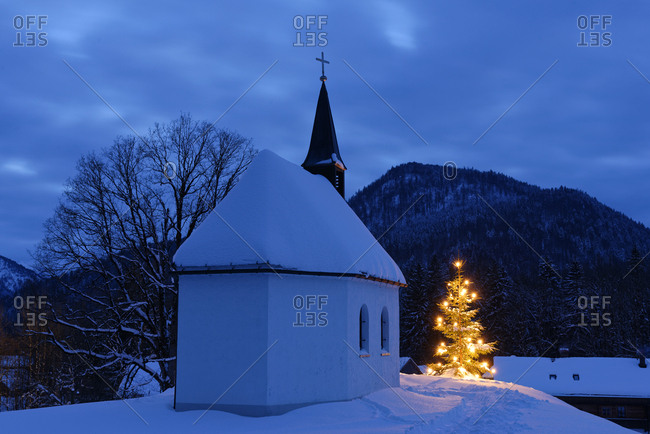 Germany- Lenggries- chapel and lighted Christmas tree