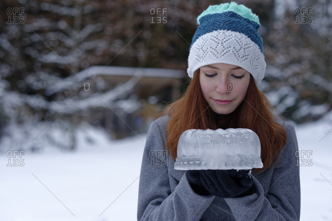 Teenage girl with cake made of ice