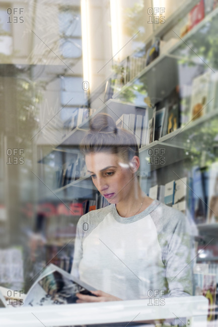 Young woman in a bookshop