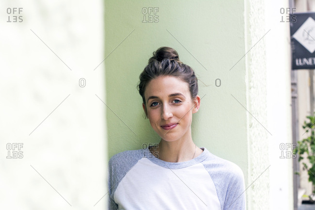 Portrait of smiling young woman with hair bun