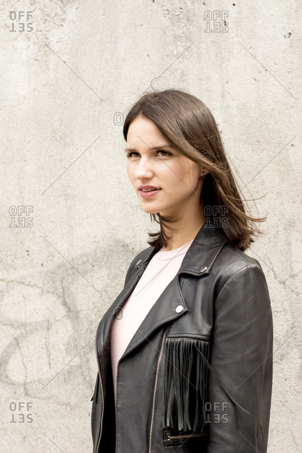 Portrait of young woman wearing black leather jacket