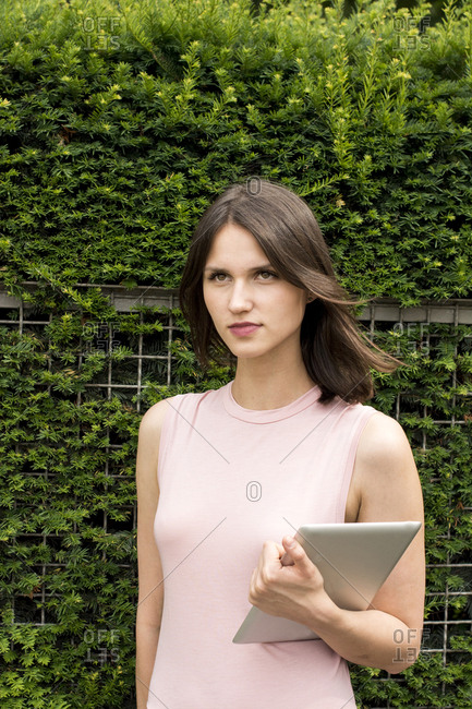 Portrait of young woman with tablet