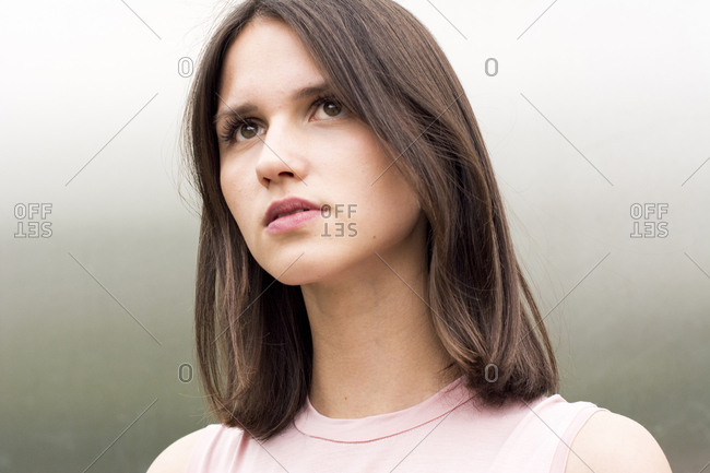 Portrait of young woman watching something