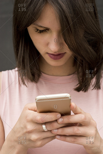 Young woman text messaging