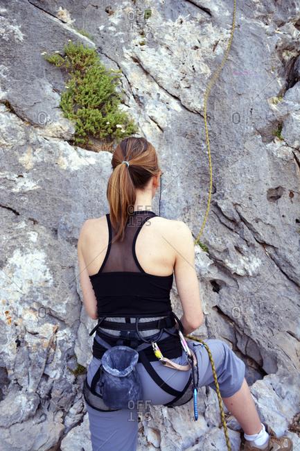 Woman preparing to climb a rock wall