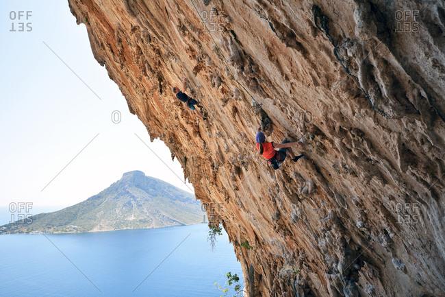 Greece- Kalymnos- two climbers in rock wall