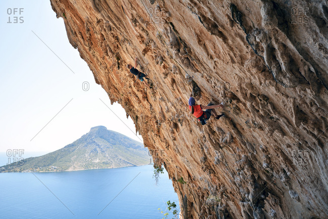 Greece- Kalymnos- two climbers in rock wall