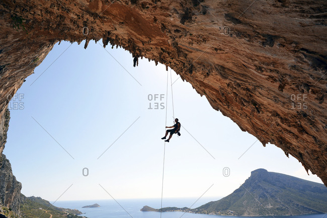 Greece- Kalymnos- climber abseiling in grotto