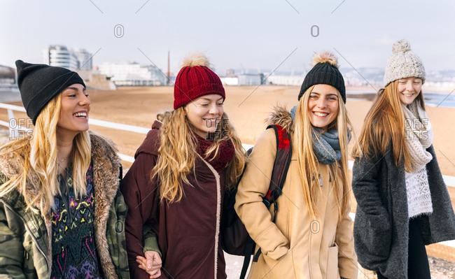 Four friends walking near the beach