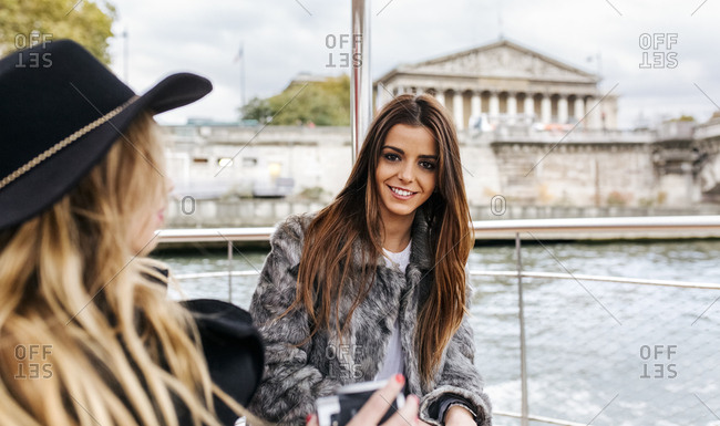 Paris- France- portrait of woman taking a cruise on Seine River with her friend