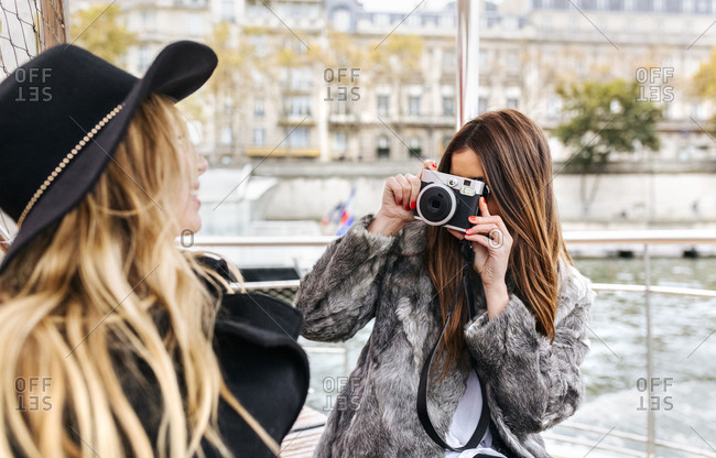 France- Paris- tourist taking picture of her friend with camera
