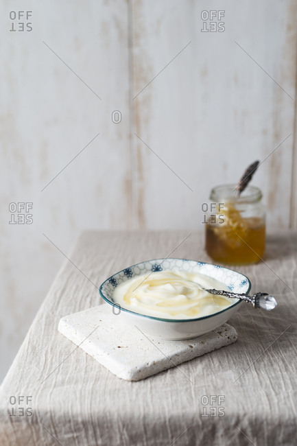 Bowl of natural yoghurt with honey