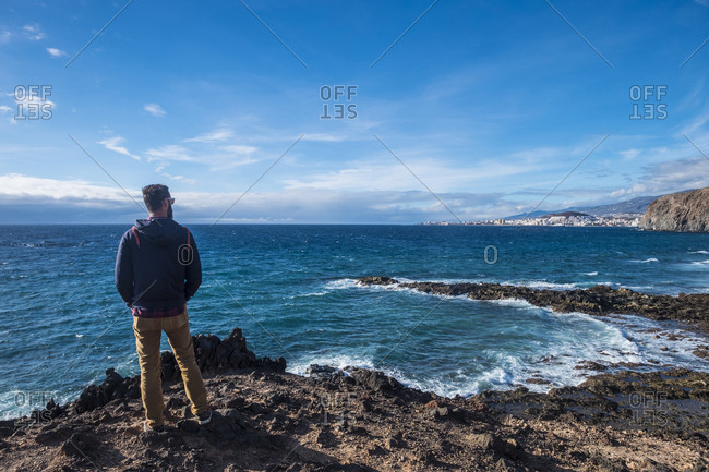 Spain- Tenerife- back view of man looking at the sea