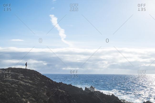 Spain- Tenerife- silhouette of man looking at the sea