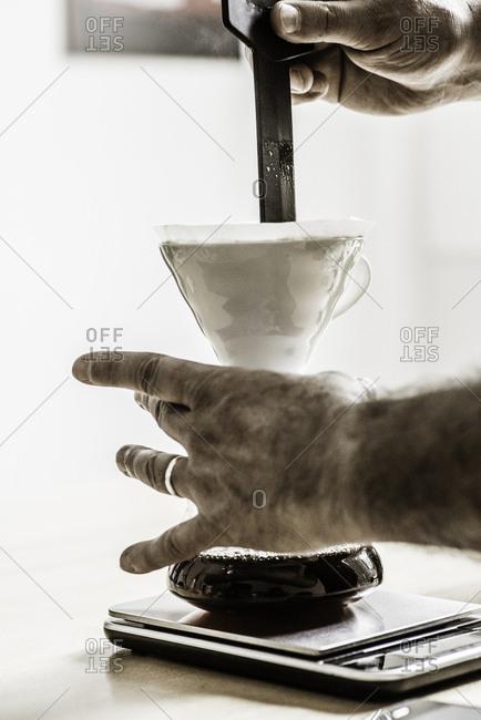 Man\'s hands preparing filter coffee