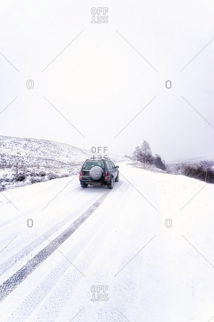 UK- Scotland- Glen Etive- Four wheel drive vehicle in winter