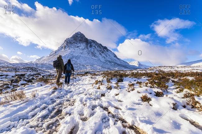 UK- Scotland- Glencoe- Buachaille Etive Mor- Male and Female walker