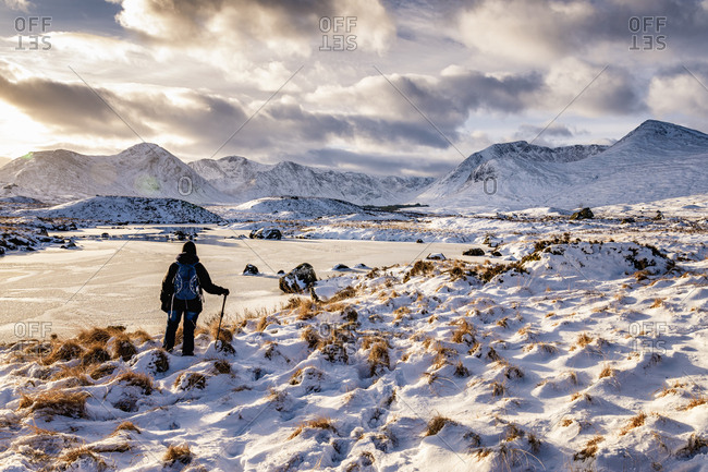 UK- Scotland- Rannoch Moor- Loch Ba and Black Mount Mountain Range- Female walker