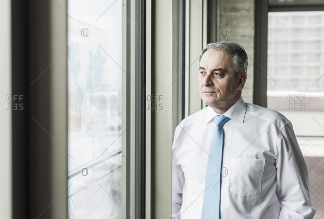 Portrait of a senior manager- looking out of window