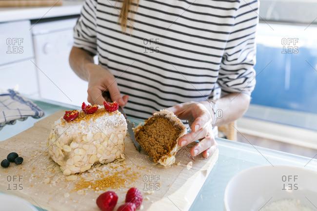 Young woman cutting up vegan cake