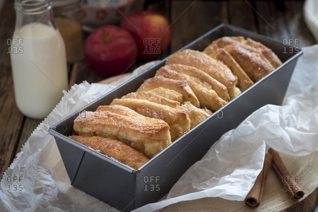 Apple pie with cinnamon sugar in cake pan