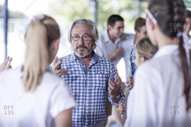 Serious teacher talking to students
