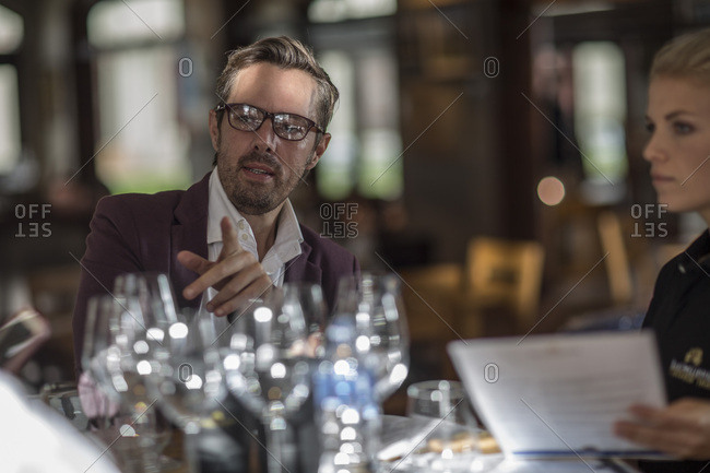Man talking to waitress in restaurant