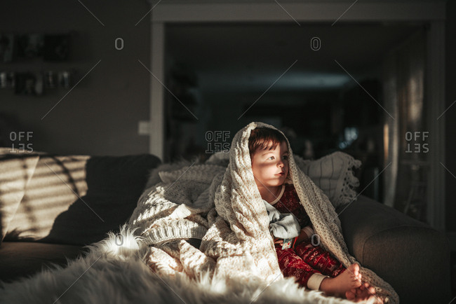 Young boy wrapped in a blanket