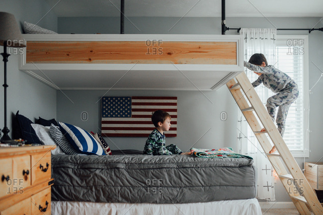Boys climbing on a bunk bed