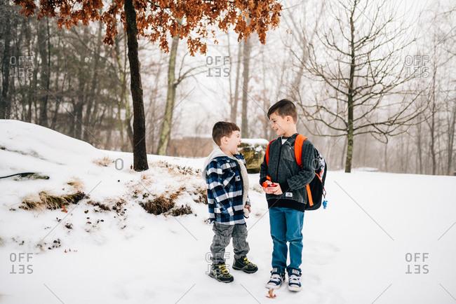 Boys outside in snow