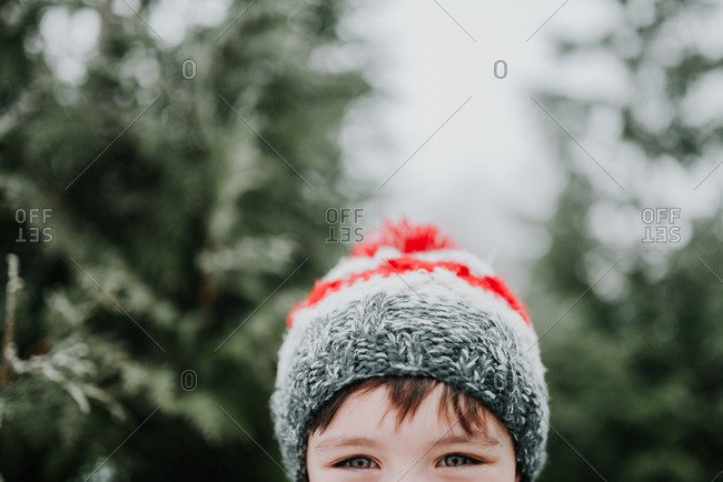Close up of little boy wearing a winter hat