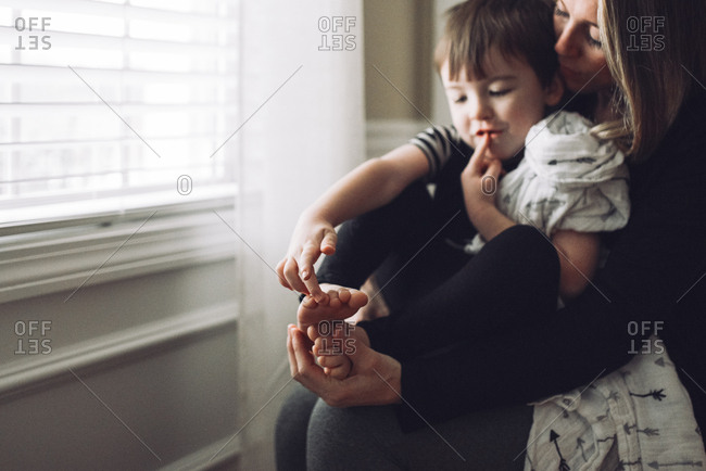 Mother and son counting toes