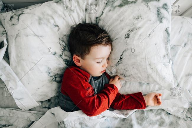Sleeping toddler boy in bed