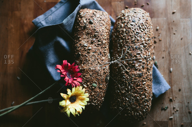 Whole wheat Bread with flowers on a Wooden Table