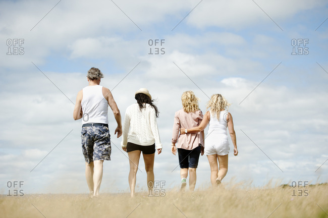 Group of friends walking in field