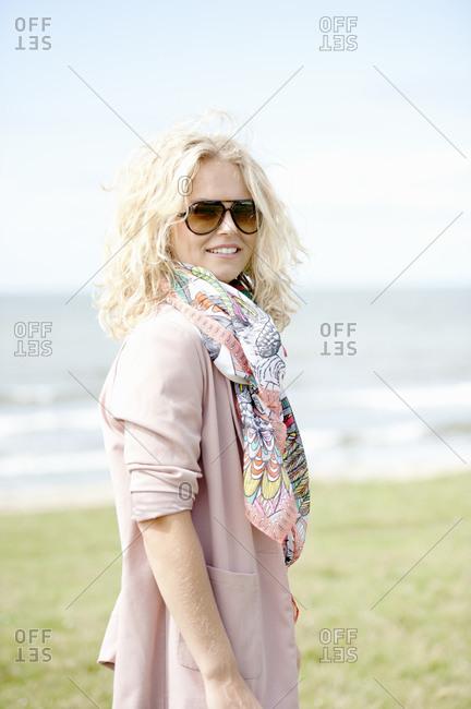 Portrait of blond woman on beach