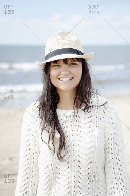 Portrait of brunette woman on beach