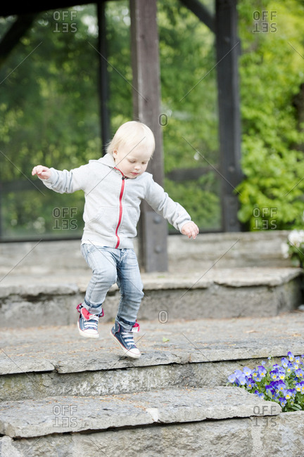 Boy jumping from step